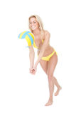 Beautiful young woman in bikini playing volleyball Stock Photography