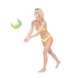 Beautiful young woman in bikini playing volleyball Royalty Free Stock Photo