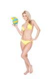 Beautiful young woman in bikini playing volleyball Stock Photo