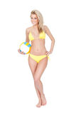 Beautiful young woman in bikini playing volleyball Royalty Free Stock Photography