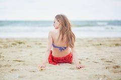 Beautiful young woman in bikini and red pareo Stock Photos