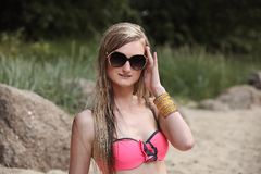 Beautiful young woman in bikini on the sunny beach Stock Photos