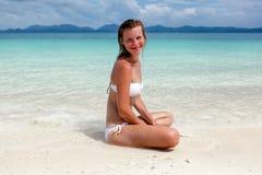 Beautiful young woman in bikini on the sunny tropical beach Stock Photography
