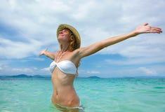 Beautiful young woman in bikini on the sunny tropical beach rela Royalty Free Stock Photography