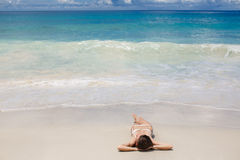 A beautiful young woman in a bikini with surfboard Royalty Free Stock Image