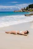 A beautiful young woman in a bikini with surfboard Stock Photos