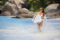 A beautiful young woman in a bikini with surfboard Royalty Free Stock Photos