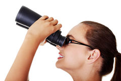 Beautiful young woman with binoculars. Stock Photo
