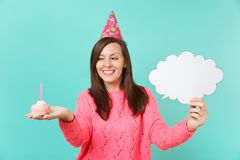 Beautiful young woman in birthday hat holding cake with candle, empty blank Say cloud, speech bubble for promotional. Content isolated on blue background royalty free stock photos