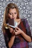 Beautiful young woman bites off chocolate Stock Photo