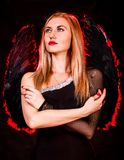 Beautiful young woman with black angel wings Royalty Free Stock Photos
