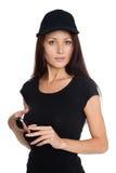 Beautiful young woman in a black baseball cap Royalty Free Stock Photo