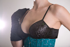 Beautiful young woman in black bra and blue corset Royalty Free Stock Images