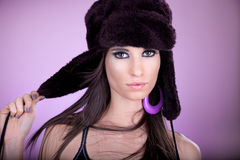 Beautiful young woman with black cap Royalty Free Stock Photo