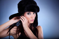 Beautiful young woman with black cap Stock Photos