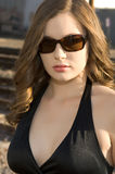 Beautiful young woman in black dress Stock Photos