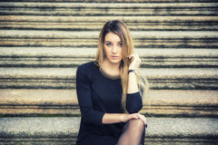 Beautiful young woman in black dress outdoor Stock Photo