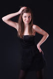 Beautiful young woman in black dress Royalty Free Stock Images