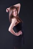 Beautiful young woman in black dress Royalty Free Stock Photos