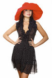 Beautiful young woman in black dress and red hat Stock Image