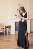 Beautiful young woman in black evening dress Royalty Free Stock Photography