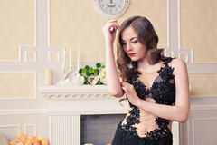 Beautiful young woman in black evening dress Royalty Free Stock Image