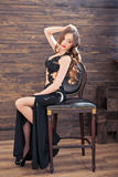 Beautiful young woman in black evening dress Stock Photo