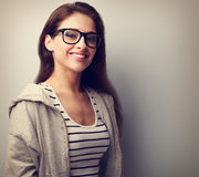 Beautiful young woman in black glasses with toothy smile. Vintag. E closeup portrait with empty copy space Royalty Free Stock Image