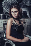 Beautiful young woman in black gothic dress Royalty Free Stock Photography