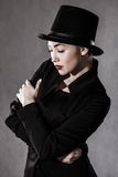 Beautiful young woman in a black hat Stock Photos