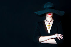 Beautiful young woman in black hat with jewel cross Royalty Free Stock Image