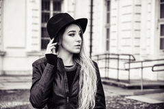 Beautiful young woman in black hat Stock Photo