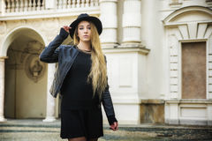 Beautiful young woman in black hat Stock Photos