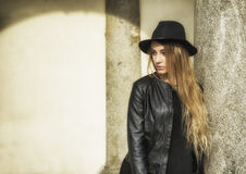 Beautiful young woman in black hat Royalty Free Stock Photography
