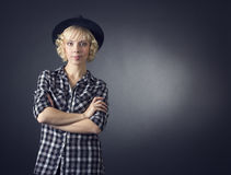 Beautiful young woman in a black hat Royalty Free Stock Images