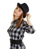 Beautiful young woman in black hat posing on white Royalty Free Stock Photography