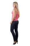 The beautiful young woman in black jeans. And pink jacket. Isolated Royalty Free Stock Image