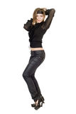 Beautiful young woman in black leather pants. Isolated Royalty Free Stock Images
