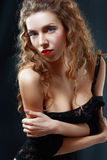 Beautiful young woman in black lingerie Stock Photography
