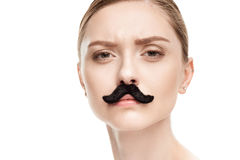 Beautiful young woman with black mustaches looking at camera. Isolated on white stock image