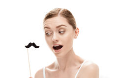 Beautiful young woman with black mustaches on stick. Isolated on white royalty free stock photo
