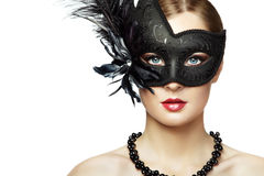 Beautiful young woman in black mysterious venetian mask Stock Photography