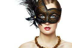 Beautiful young woman in black mysterious venetian mask stock images