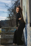Beautiful young woman. Young woman with black overalls posing outdoor Royalty Free Stock Images