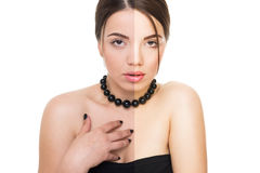 Beautiful young woman in black before and after retouch Royalty Free Stock Image