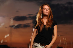 Beautiful young woman in black shirt Stock Images