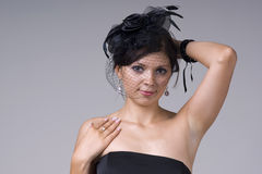 Beautiful young woman in black soiled Royalty Free Stock Image
