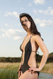 Beautiful young woman in a black trikini swimsuit Stock Images