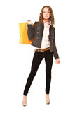 Beautiful young woman in black trousers. With orange handbag isolated stock photography