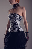 Beautiful young woman in black and white corset Stock Image